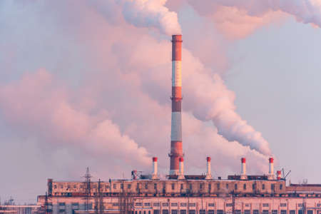 Industrial zone with factory chimneys producing smoke.