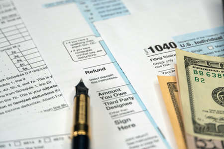 Refund of tax, filling Form 1040 U.S. Individual Income Tax. Tax Payment Concept Reklamní fotografie