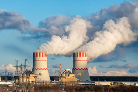 Nuclear power plant with Cooling towers of Atomic energy power station with emission of steam in the air atmosphere. Reklamní fotografie