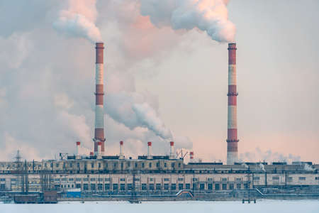 Environmental problem of pollution of environment and air in cities. Smoking industrial zone factory chimneys