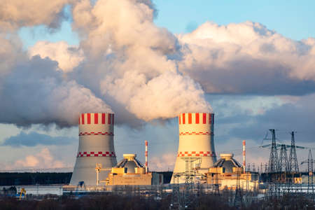 Cooling tower with steam of Atomic nuclear power station Reklamní fotografie