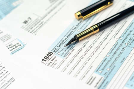 1040 Tax Return Form with a Pen. United States federal income tax return