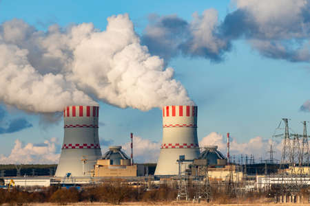 Cooling towers of Nuclear power plant emissions of steam in the air atmosphere. Industrial zone with power station atomic nuclear energy production Stock fotó