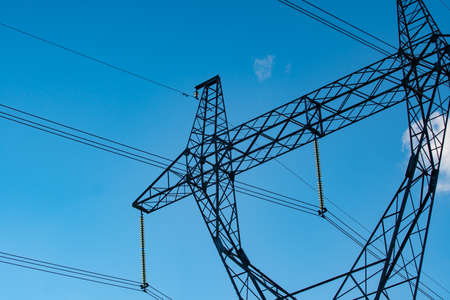 Industrial high voltage electricity line tower. Energy technology Stock fotó