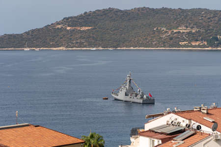 Turkish naval forces military ship in mediterranean sea in bay. Warship patrol protection of border.