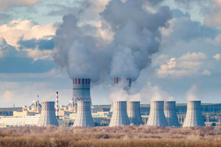 Nuclear power plant with Cooling tower of Atomic power station. Industrial zone with emission of steam in the air atmosphere Stock fotó