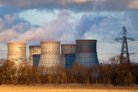 Cooling tower of Atomic power station with nuclear reactor. Industrial zone with Nuclear power plant with emission of steam in the air atmosphere. Stock fotó