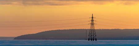 Industrial high voltage electricity tower with sky sunrise. Wide banner Reklamní fotografie