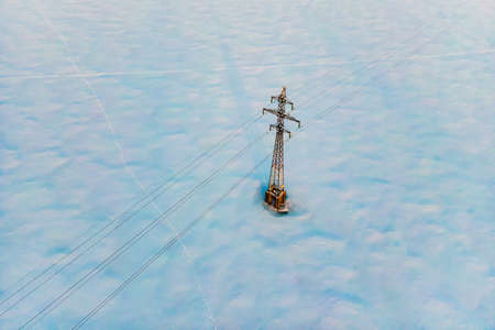 Industrial high voltage electricity line tower, aerial view. Energy technology Stock fotó