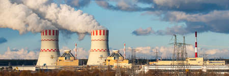 Nuclear power plant with Cooling towers of Atomic energy power station with emission of steam in the air atmosphere. Stock fotó