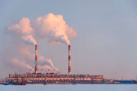 Industrial factory pipes emission carbon gases in atmosphere
