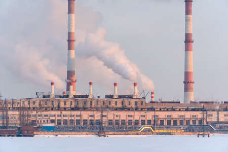 Industrial factory emissions of carbon gases with smoke in atmosphere Stock fotó