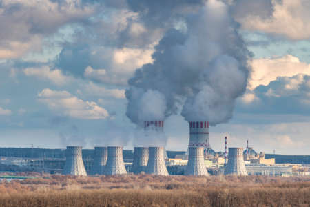Cooling towers of Nuclear power plant emissions of steam in the air atmosphere. Industrial zone with power station atomic nuclear energy production Reklamní fotografie