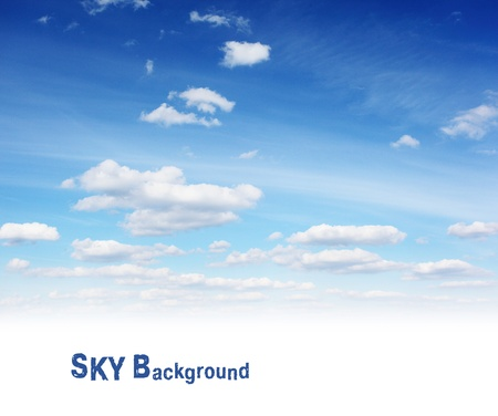 White fluffy clouds in the blue sky photo