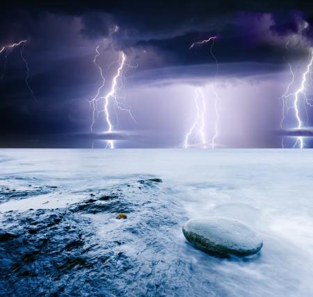 summer storm beginning with lightning photo
