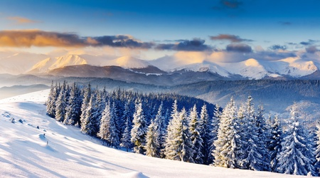 winter sunrise: Majestic sunset in the winter mountains landscape. Dramatic sky.