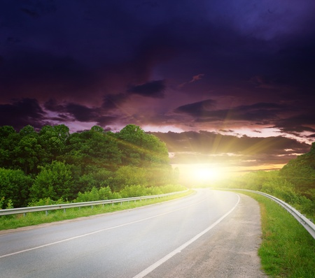 roadways: Empty road with cloudy sky and sunlight