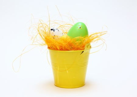 Easter eggs and chickens on white isolated background photo