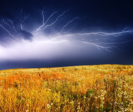 Thunderstorm with lightning in green meadow  photo