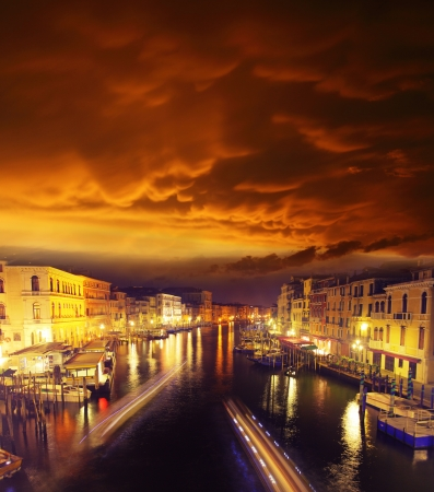 Grand Canal at night, Italy. Magic red sky. photo