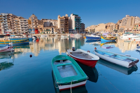 Malta: Colorful traditional fishing boats in the mediterranean island of Malta. Stock Photo