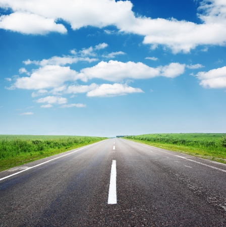 move ahead: Empty asphalt road with cloudy sky and sunlight