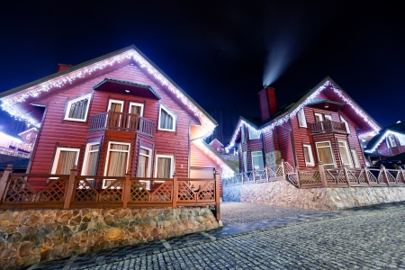 lighted: Houses decorated and lighted for christmas at night Stock Photo