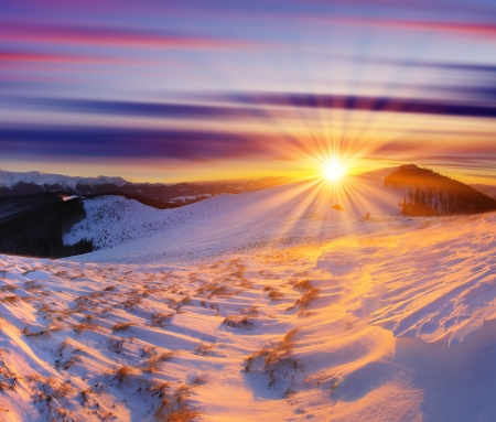 Majestic sunset in the winter mountains landscape. HDR image photo
