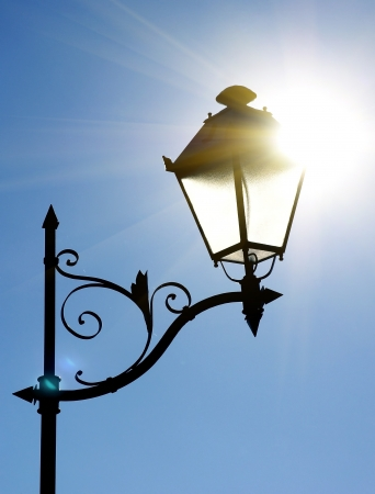 Decorative street lantern on blue sky background.  photo