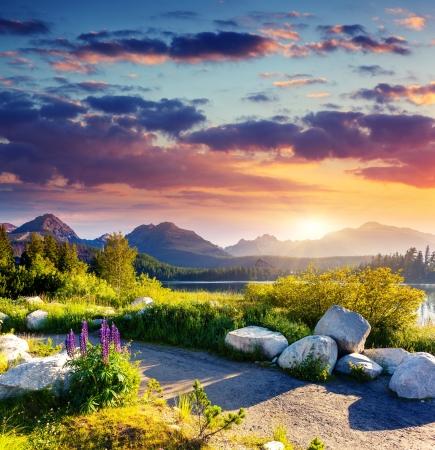sunrise lake: Mountain lake in National Park High Tatra  Dramatic overcrast sky  Strbske pleso, Slovakia, Europe  Beauty world  Stock Photo