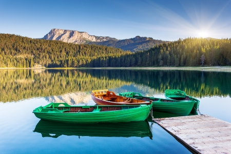 Reflection in water of mountain lakes and boats  Black lake in Durmitor national park in Montenegro, Europe  Beauty world  photo