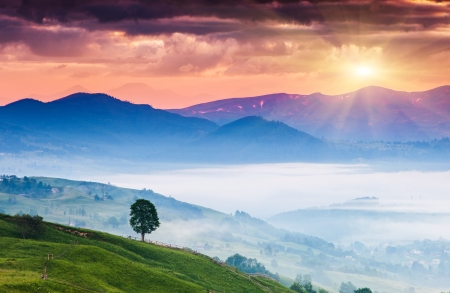 Majestic sunset in the mountains landscape. Carpathian, Ukraine, Europe. Beauty world. Stock Photo