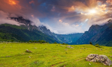 caucasus: Majestic colorful sunset in the mountains landscape. Upper Svaneti, Georgia, Europe. Caucasus mountains. Beauty world. Stock Photo