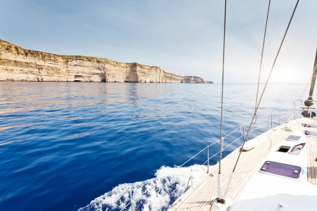 sailing crew: The yacht is moving along the coast Stock Photo