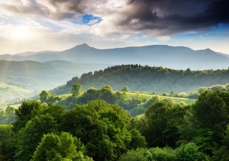 Majestic mountains landscape under morning sky with clouds. Overcast sky before storm. Carpathian, Ukraine, Europe. 版權商用圖片