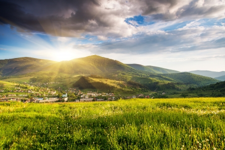 country landscape: Majestic mountains landscape under morning sky with clouds. Overcast sky before storm. Carpathian, Ukraine, Europe. Stock Photo