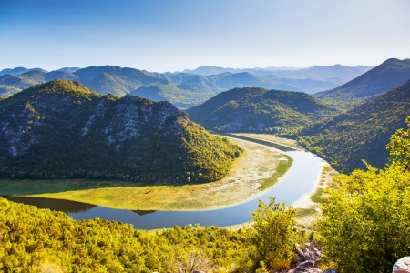 sinuous: Sinuous river flowing through mountains. Rijeka Crnojevica. Located near Skadar Lake, Montenegro, Europe. Beauty world. Stock Photo