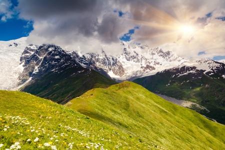 shkhara: Alpine meadows at the foot of  Mt. Shkhara, Chkhutnieri pass. Upper Svaneti, Georgia, Europe. Caucasus mountains. Beauty world.