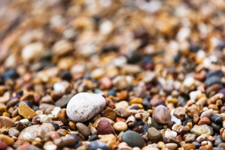 A close up view of smooth polished multicolored stones on the beach. Crimea, Ukraine, Europe. Beauty world. photo