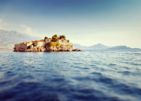 Sveti Stefan, small islet and resort in Montenegro. Balkans, Adriatic sea, Europe. Beauty world. Tilt-shift effect photo