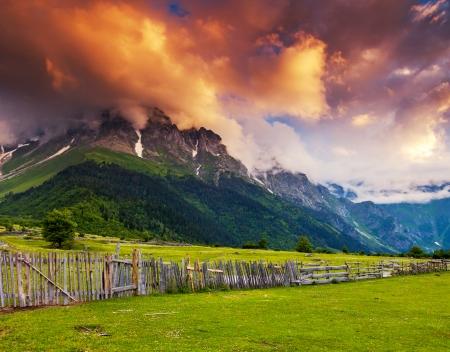 Majestic colorful sunset at the foot of  Mt. Ushba. Upper Svaneti, Georgia, Europe. Caucasus mountains. Beauty world. photo
