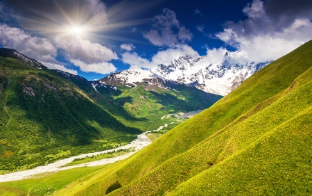Alpine meadows at the foot of  Mt. Shkhara. Upper Svaneti, Georgia, Europe. Caucasus mountains. Beauty world. photo