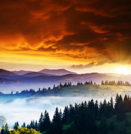 carpathian mountains: Majestic sunset in the mountains landscape. Overcast sky before storm. Carpathian, Ukraine, Europe. Beauty world. Stock Photo