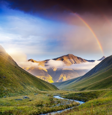 Majestic mist landscapes with high mountains of Georgia, Europe. Dramatic sky. Caucasus mountains. Beauty world. Stock Photo
