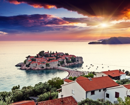 Sveti Stefan, small islet and resort in Montenegro. Overcast sky. Balkans, Adriatic sea, Europe. Beauty world photo