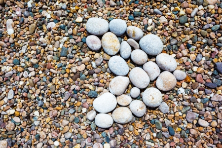 Pebble Beach: A close up view of smooth polished multicolored stones on the beach. Crimea, Ukraine, Europe. Beauty world.