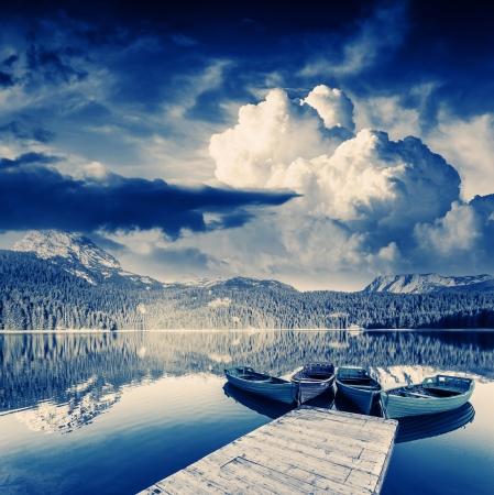 Black lake in Durmitor national park in Montenegro. Dramatic overcast sky. Balkans, Europe. Beauty world.  photo
