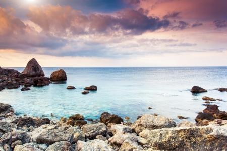 Majestic summer sunset over the sea. Dramatic overcast sky with colorful cloud. Crimea, Ukraine, Europe. Beauty world. Zdjęcie Seryjne