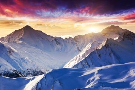 snow climbing: Fantastic evening winter landscape. Colorful overcast sky. Austria, Europe. Beauty world. Stock Photo