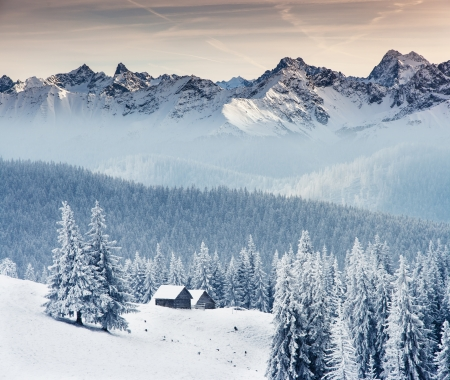 mountain hut: Fantastic winter landscape. Dramatic overcast sky. Creative collage. Beauty world.